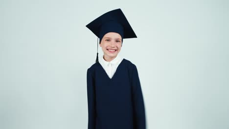 Portrait-Happy-Graduate-Girl-7-8-Years-In-The-Mantle-Smiling-With-Teeth