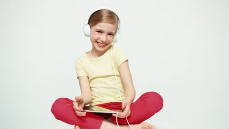 Portrait-Laughing-Girl-7-8-Years-Old-Using-Tablet-PC-On-White-Background