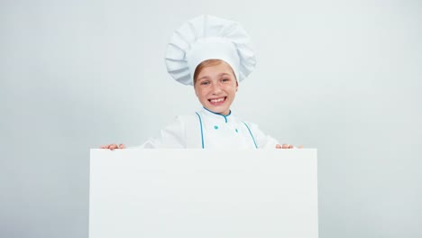 Portrait-Laughing-Little-Chef-Cook-In-Cap-With-White-Board-Isolated-On-White