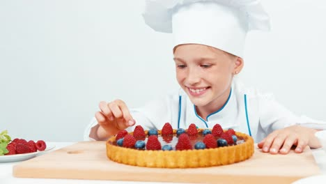 Portrait-Little-Chef-Cook-Decorating-The-Cake-In-Chef-Uniform