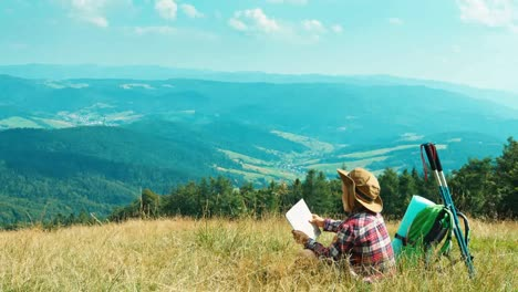 Little-Hiker-Child-Girl-7-8-Years-Using-Tourist-Map-And-Sitting-On-Grass