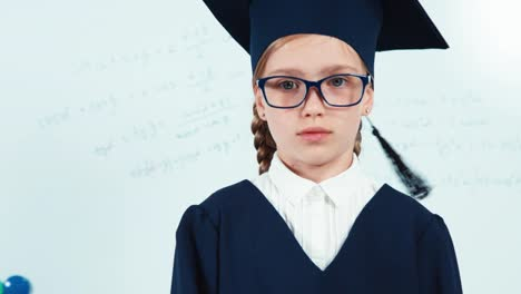 Portrait-Little-Student-Girl-7-8-Years-Graduate-In-The-Mantle-Looking-At-Camera