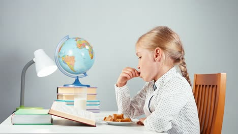 Portrait-Profile-Blonde-School-Girl-7-8-Years-Reading-Book-Eating-Candy