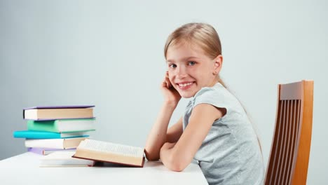 Portrait-Profile-Girl-Child-7-8-Years-Old-Reading-Textbook-One-Hand-Near-Face