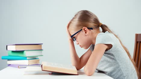 Portrait-Profile-Sad-Girl-7-8-Years-Old-Reading-Book-And-Looking-At-Camera