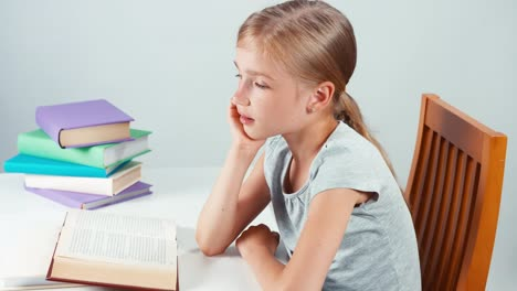 Portrait-Profile-Student-Girl-7-8-Years-Reading-Book-And-Smiling-At-Camera