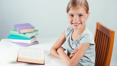 Portrait-Profile-Student-Girl-Child-7-8-Years-Reading-Book-And-Smiling-At-Camera