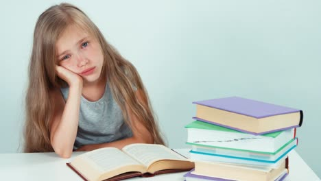 Portrait-Sad-Schoolgirl-7-8-Years-Old-Reading-Book-At-The-Table-On-White