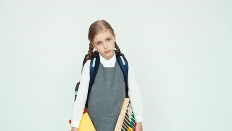 Sad-schoolgirl-with-a-backpack-holds-an-abacus-and-books-1