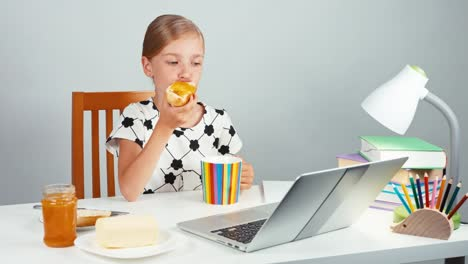 Portrait-School-Girl-7-8-Years-Eating-Sandwich-With-Butter-And-Jam