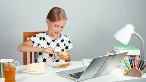 Portrait-School-Girl-7-8-Years-Making-Sandwich-With-Butter-And-Jam