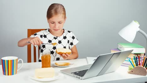Portrait-School-Girl-7-8-Years-Making-Sandwich-With-Butter-And-Jam-Using-Knife