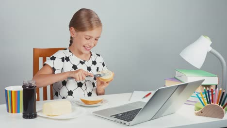 Portrait-School-Girl-7-8-Years-Using-Knife-Making-Sandwich-With-Butter