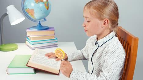 Portrait-Schoolgirl-7-8-Years-Eating-Lollipop-And-Reading-Book