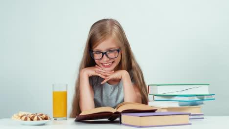 Portrait-Schoolgirl-7-8-Years-Old-In-Glasses-Reading-Textbook-At-Her-Desk