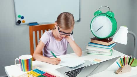 Portrait-Schoolgirl-7-8-Years-Old-In-Glasses-Something-Writing-In-Notebook