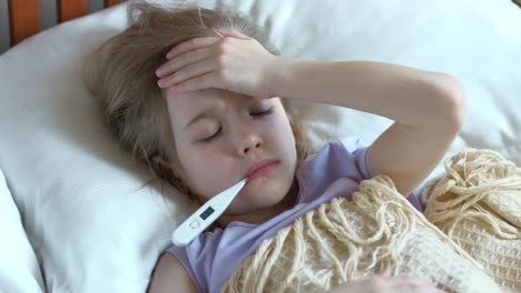 Portrait-Sick-Girl-7-Years-Old-Lying-On-A-Bed-With-Thermometer