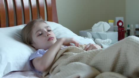 Portrait-Sick-Girl-7-Years-Old-Lying-On-A-Bed-Girl-Takes-The-Thermometer