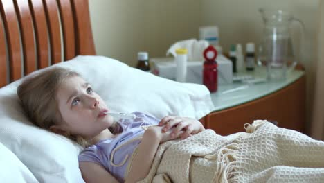 Portrait-Sick-Girl-7-Years-Old-Girl-Lying-On-A-Bed-Under-The-Blanket
