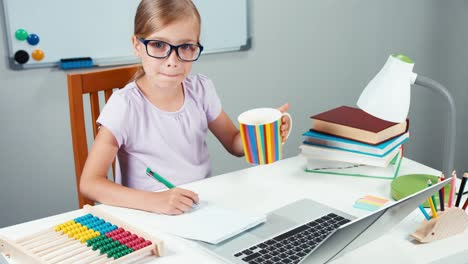 Portrait-Student-Girl-7-8-Years-Doing-Homework-And-Drinking-Tea-From-Cup
