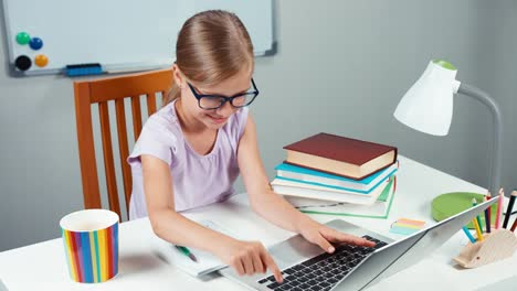 Portrait-Student-Girl-7-8-Years-Doing-Homework-With-Laptop