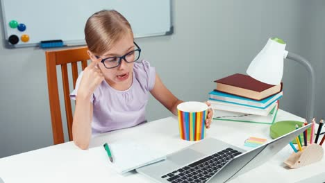 Portrait-Student-Girl-7-8-Years-Thinking-About-Something-And-Finger-Up