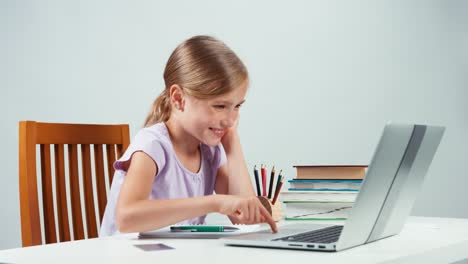 Portrait-Student-Girl-7-8-Years-Using-Credit-Card-And-Shopping-Online-By-Laptop-01