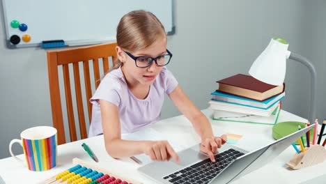 Portrait-Student-Girl-7-8-Years-Using-Laptop-And-Rejoicing