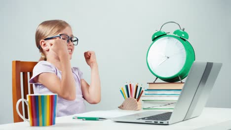 Portrait-Student-Girl-7-8-Years-Using-Laptop-And-Rejoicing-Hands-Up