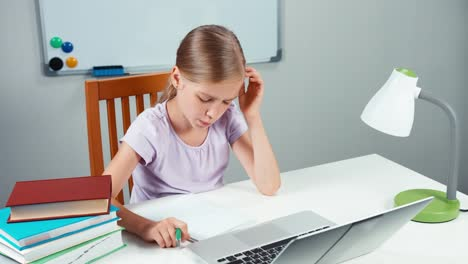 Portrait-Student-Girl-7-8-Years-Writing-In-Her-Notebook-And-Something-Typing