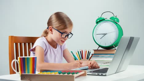 Portrait-Student-Girl-Child-7-8-Years-Sitting-In-Her-Desk-And-Something-Writing