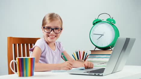 Portrait-Student-Girl-Child-7-8-Years-Sitting-Writing-In-Her-Exercise-Book
