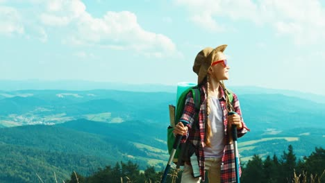 Portrait-Tourist-Girl-Child-With-Backpacks-7-8-Years-Against-The-Mountains