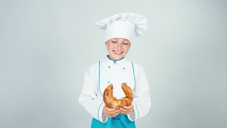 Portrait-Young-Baker-Breaks-Bread-Bagel-Gives-You-One-Piece-At-Camera