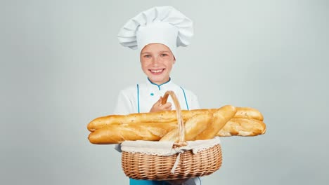 Portrait-Young-Baker-Girl-7-8-Years-Holds-Basket-With-Long-Loaves-And-Smiling