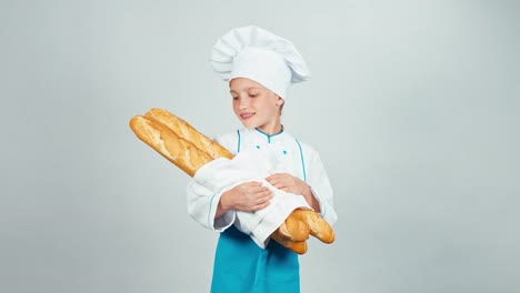 Portrait-Young-Baker-Girl-Child-Holds-Long-Loaves-And-Smiling-At-Camera-Isolated