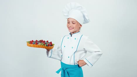 Portrait-Young-Baker-Holding-In-One-Her-Hand-Chocolate-Cake-With-Sweets-Fruits