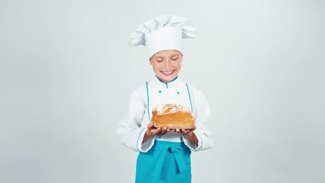 Portrait-Young-Baker-Holds-Square-Bread-In-Her-Hands-And-Gives-Loaf-At-Camera