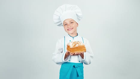 Portrait-Young-Baker-Sniffing-Square-Bread-And-Gives-Loaf-At-Camera-And-Smiling