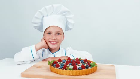 Portrait-Young-Chef-Made-Cake-And-Looking-At-It-And-Smiling-At-Camera