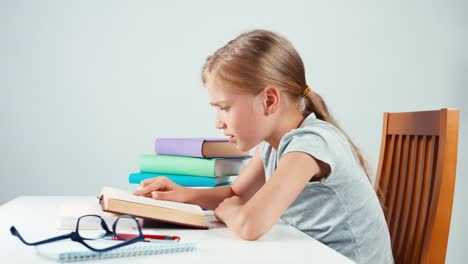 Profile-Portrait-Girl-Child-Student-Reading-Book-In-The-Table