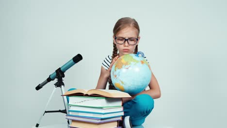 School-Girl-7-8-Years-Using-Her-Globe-And-With-Surprised-Looking-At-Camera