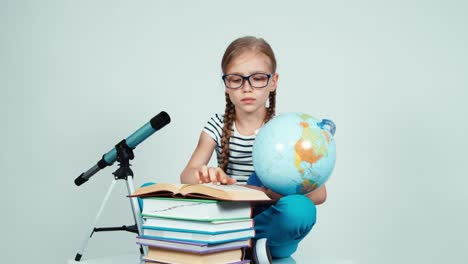 School-Girl-7-8-Years-Using-Her-Globe-Sitting-On-The-Floor