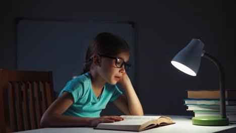 School-Girl-7-8-Years-Yawns-And-Falling-Asleep-On-The-Book-In-The-Night