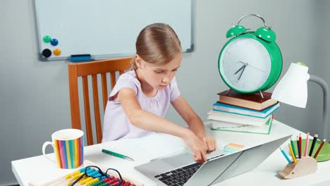 School-Girl-Something-Typing-On-Laptop-Very-Slowly-And-Smiling-At-Camera