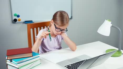 Schoolgirl-7-8-Years-Doing-Homework-In-Mathematics-In-Her-Desk