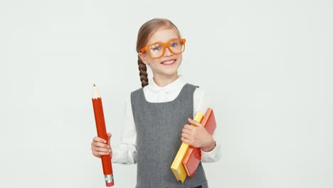 Schoolgirl-7-8-Years-Old-With-Glasses-Holding-Books-And-A-Big-Pencil-Child