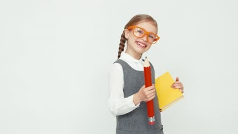 Schoolgirl-Child-7-8-Years-Smiling-At-Camera-Girl-With-Glasses-Holding-Books