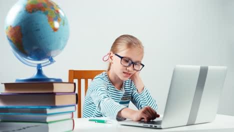 Schoolgirl-Child-7-8-Years-Using-Her-Laptop-In-The-Her-Desk