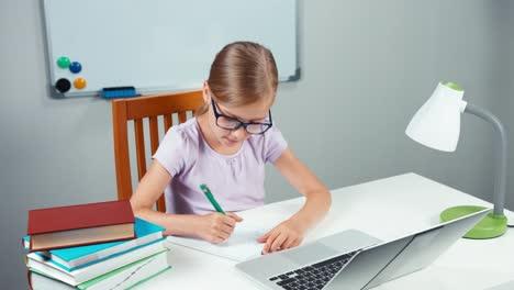 Schoolgirl-Doing-Homework-In-Mathematics-I-Her-Desk